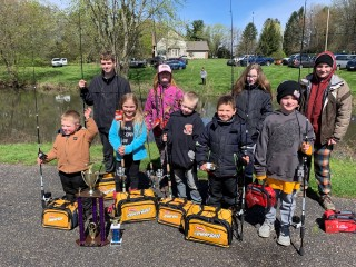 Children with fishing poles and prizes