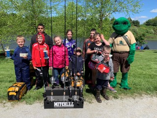 Kids with fishing poles and prizes