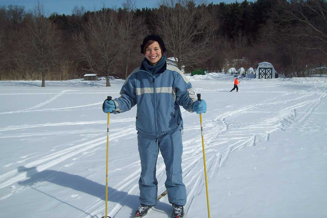 Smiling Woman on Skis
