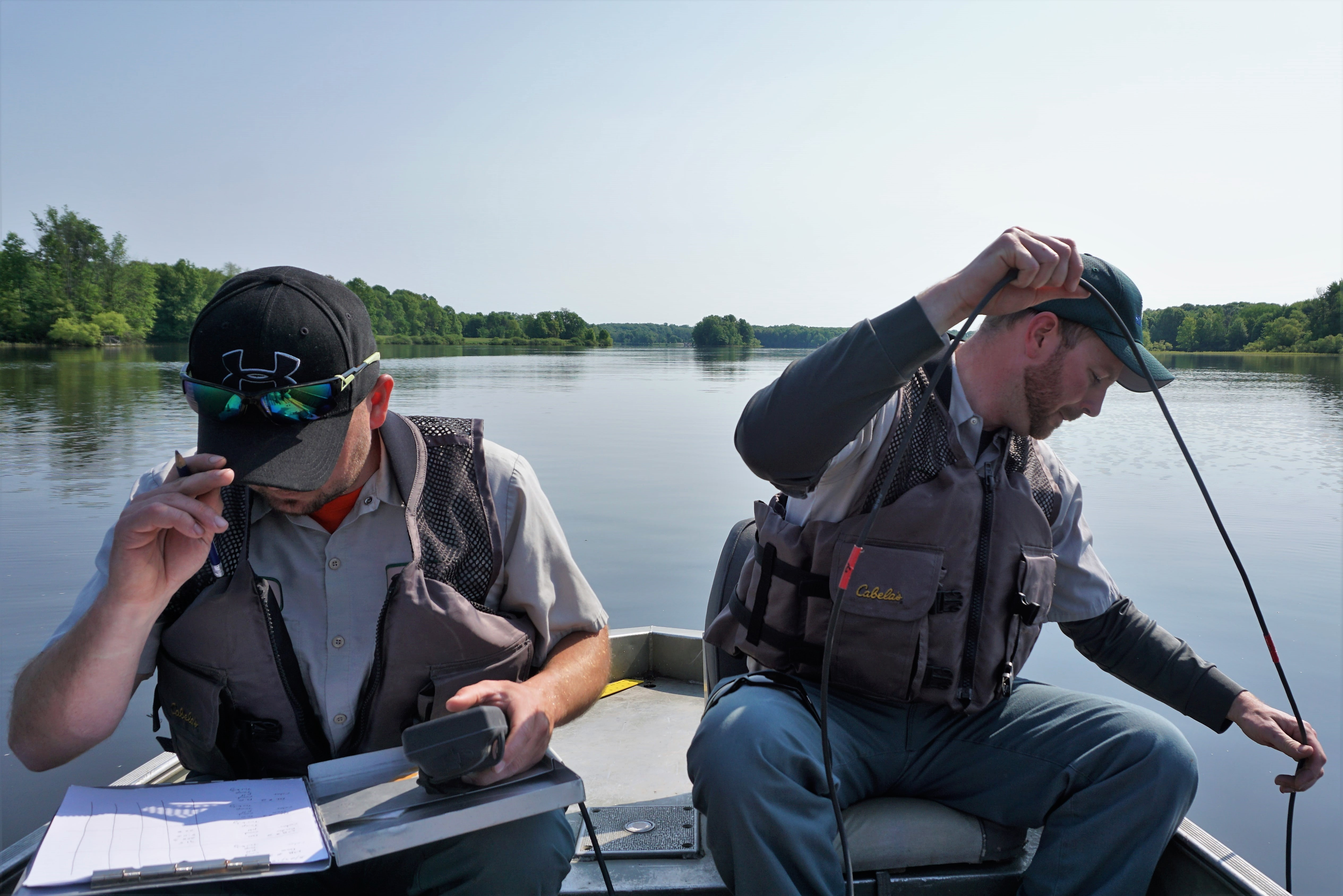 Natural Resources testing water from row boat at Walborn Reservoir