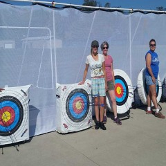 Women and Archery Targets with arrows