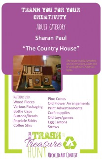 """Trash to Treasure submission of a fully furnished country """"house"""" made from woof pieces, various packaging, bottle caps, buttons/beads, popsicle sticks, coffee stirs, pine cones, old flower arrangements, print advertisements, craft supplies, old toys/games, egg cartons, and straws"""