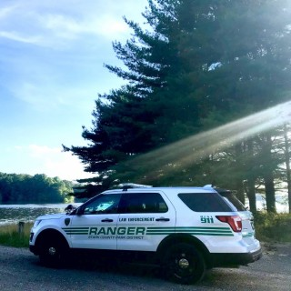 Stark Parks Ranger vehicle with water & trees