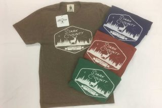 Open and folded tee shirts with Stark County Park District logo