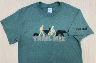 Trail mix written on shirt with logo