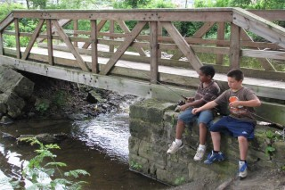 Two boys fishing at Cook's Lagoon Bridge