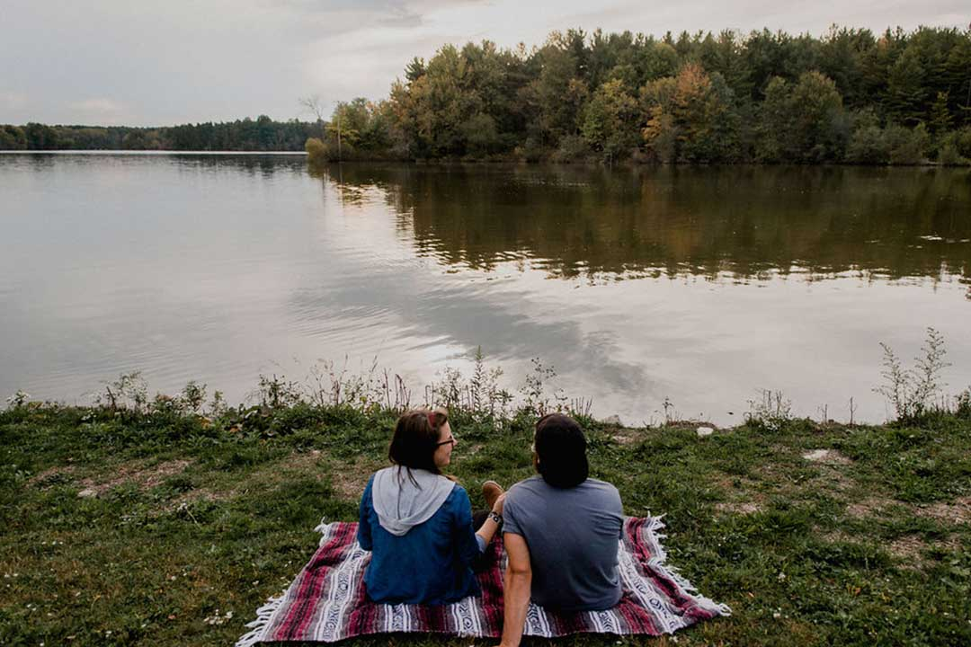 Couple on Blanket looking over Reservoir