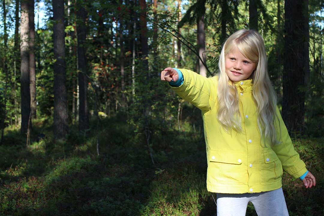Girl Pointing in woods